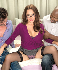 Raquel Sieb takes on two cocks in a hot milf threesome.